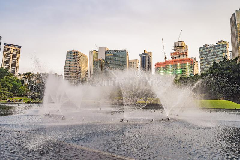 Kuala Lumpur, Malaysia, November 18, 2018: Fountain on the lake in the evening, near by Twin Towers with city on royalty free stock photo
