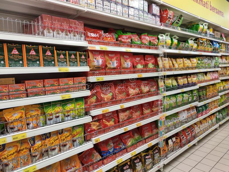 Tea powder is sold in commercial packages and displayed on supermarket shelves for sale. royalty free stock photos