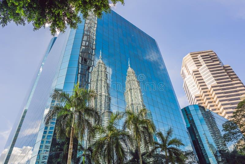 Kuala Lumpur, Malaysia - 03.26.2019: Petronas Twin Towers, the symbol skyscraper of Kuala Lumpur. reflected in the stock photos