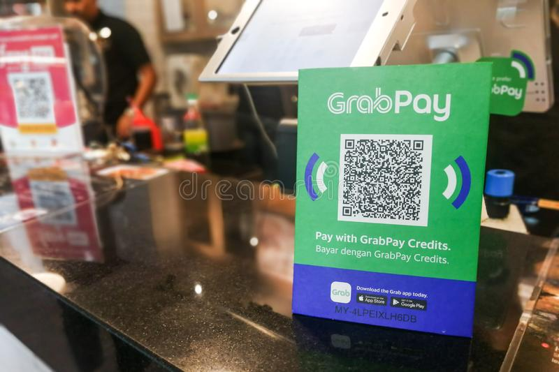 KUALA LUMPUR, MALAYSIA, September 17, 2019: Retail outlet restaurant displaying signage of Grabpay.  Online payment via Grabpay is royalty free stock photography