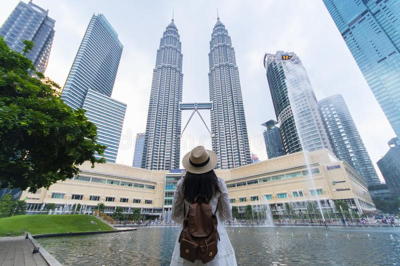 A woman tourist is sightseeing the Petronas Twin tower KLCC in Kuala Lumpur. stock images