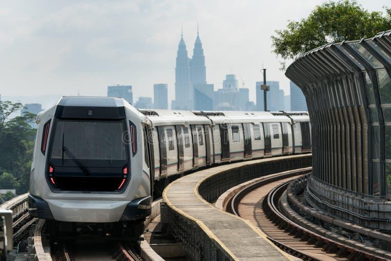 Kuala Lumpur Mass Rapid Transit MRT train approaching towards stock photo