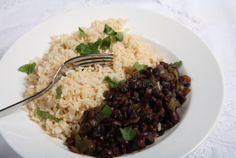 Kubanische schwarze Bohnen und Reis lizenzfreies stockfoto
