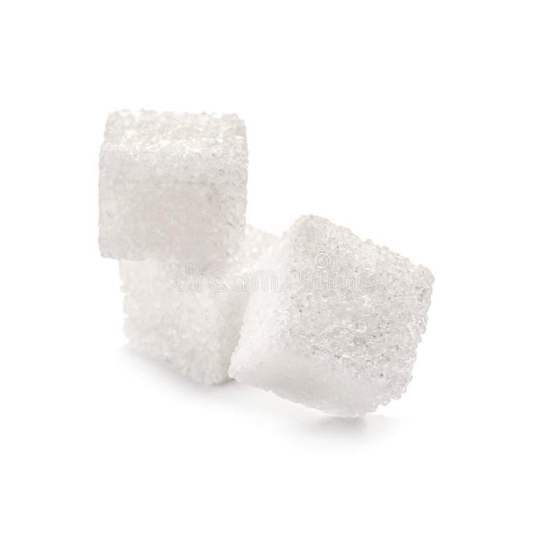 Kuber för förädlat socker på vit bakgrund fotografering för bildbyråer