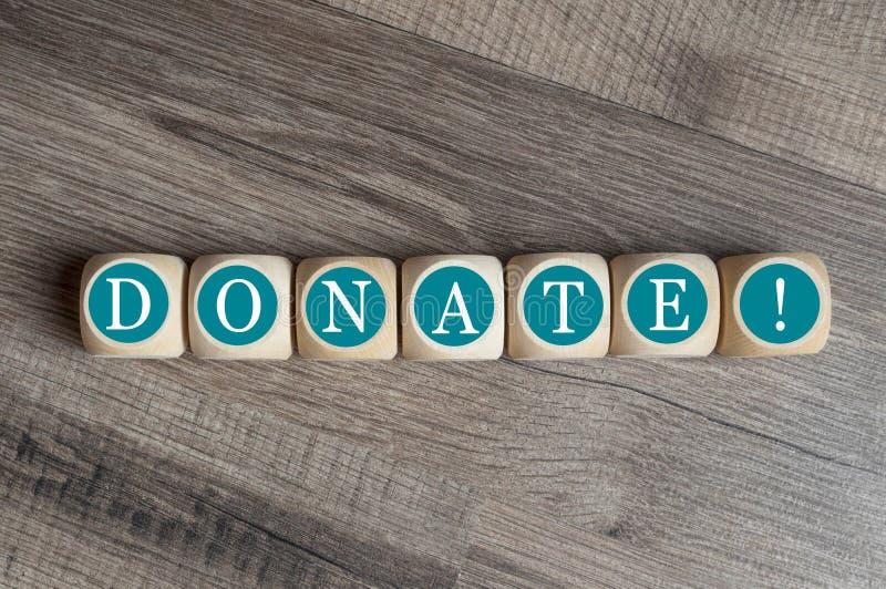 Kuber och tärning med att donera royaltyfri foto
