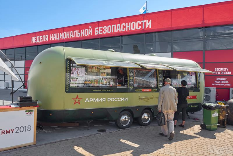 KUBINKA, RUSSIA, AUG.24, 2018: View on fast food meals on wheels trailer in military green colors onrussian weapon exhibition Army. 2018. Street cafe trailer royalty free stock photos