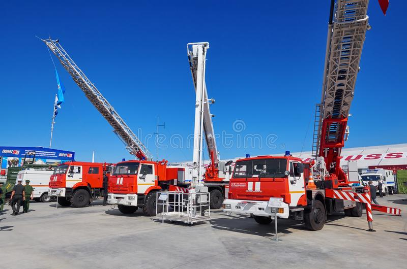 KUBINKA, RUSSIA, AUG.24, 2018: View on Russian firefighting trucks on Kamaz platforms with equipment for different purposes. Red w royalty free stock photography