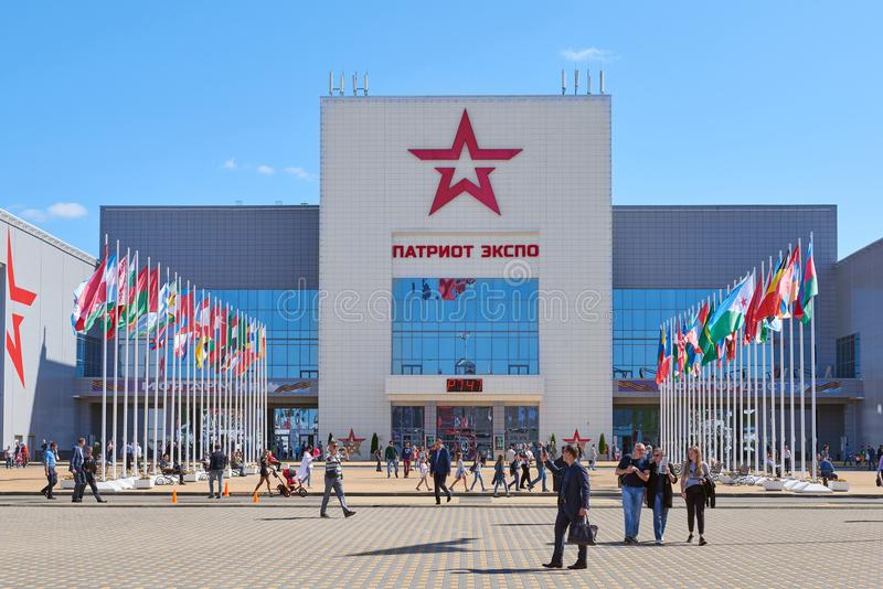KUBINKA, RUSSIA, AUG.24, 2018: View on white building with Russian Army star - Patriot Expo pavilion entrance and different people. In front. International royalty free stock photos