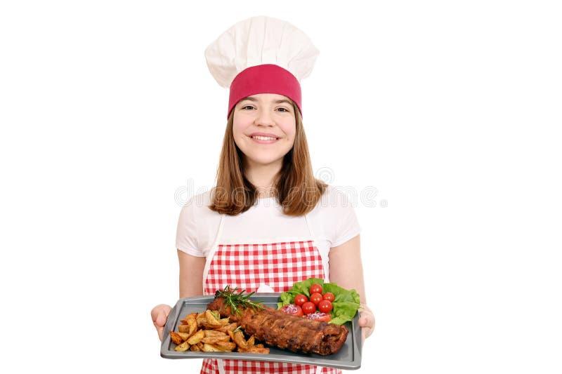 Kucharz z żeberkami wieprzowymi zdjęcie stock