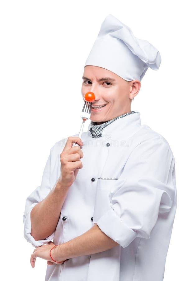 kucharzi z czereśniowym pomidorem na rozwidleniu, strzał na białym tle fotografia royalty free