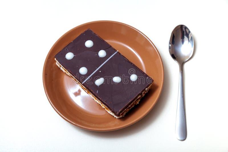 Kuchen in der Form der rechteckigen Dominofliese stockfoto