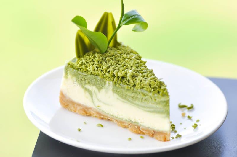 Kuchen des Käsekuchens oder des grünen Tees lizenzfreies stockfoto