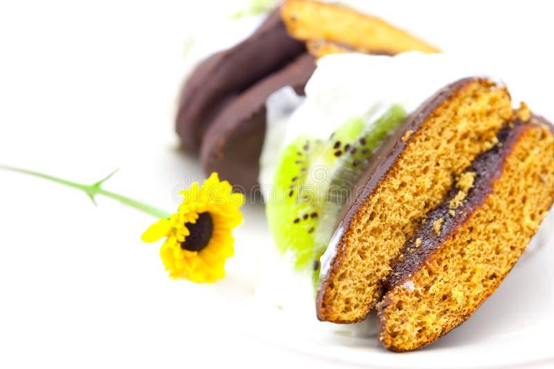 Kuchen in Form des Inneren und einer Blume lizenzfreies stockfoto