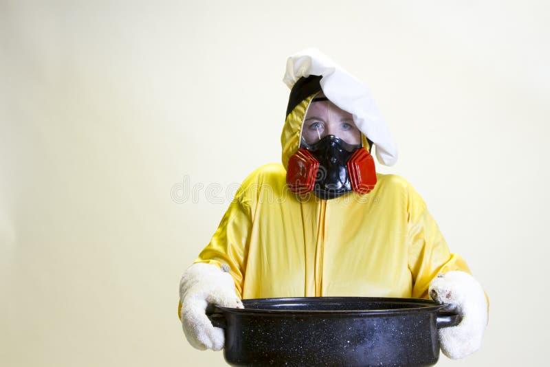 Kuchenna katastrofa, hazmat kostium i szefa kuchni kapelusz, zdjęcia royalty free