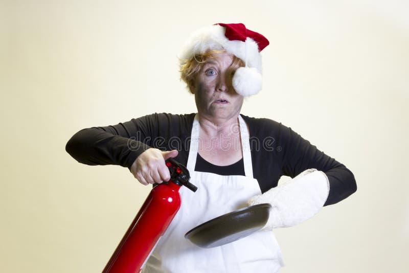 Kuchenna katastrofa, Santa kapelusz i pożarniczy gasidło, obrazy stock