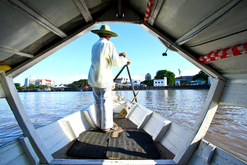 Kuching Boatman. Boatman of a river taxi in Kuching, Sarawak, Malaysia. Such taxi services are used to ferry passengers across the river stock photo