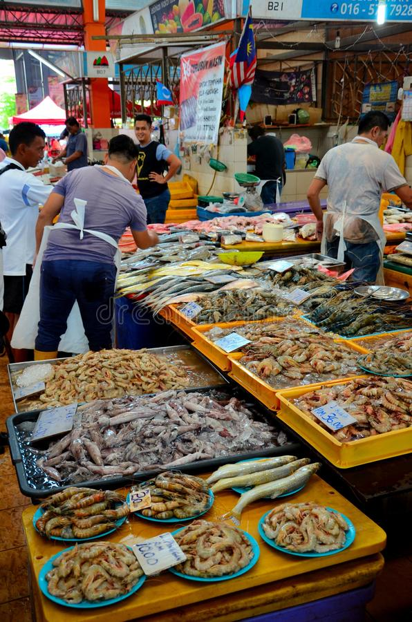 Malaysian fresh seafood fish seller at stall Satok Weekend Market Kuching Sarawak Malaysia stock image