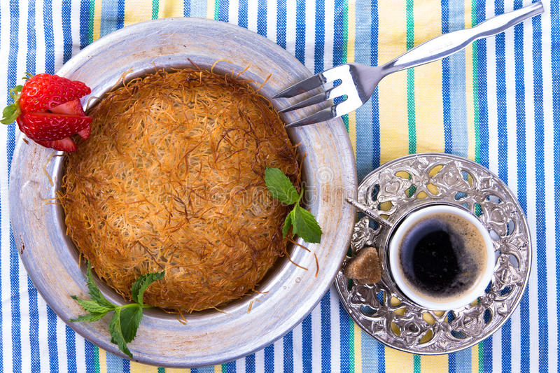 Kuefe on the table cloth with Turkish Coffee royalty free stock image