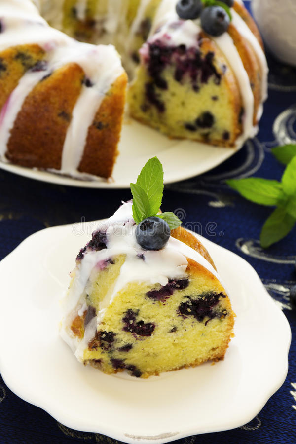 Kugelhopf cake with blueberries. And lime, with a glaze royalty free stock photography