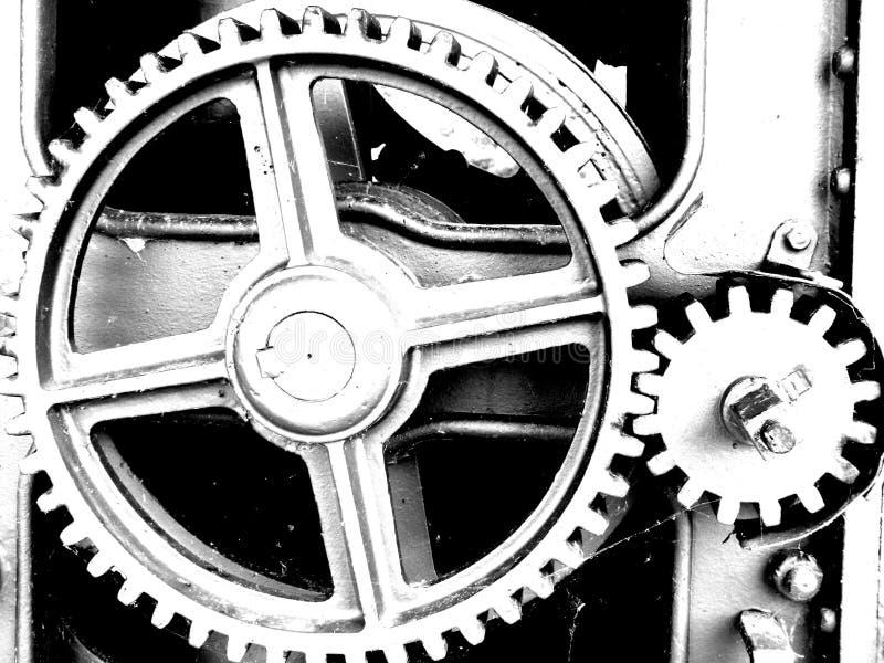 Kugghjul med olika storleksanpassade kugghjul i svartvitt fotografering för bildbyråer