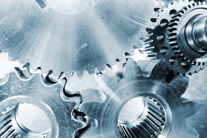 Kugghjul och kugghjul i ståltoning arkivfoton