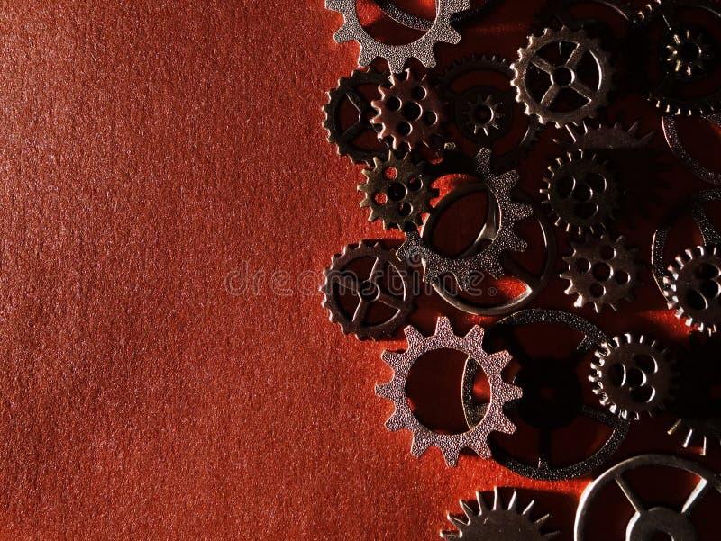 Kugghjul på texturerad bakgrund royaltyfri fotografi