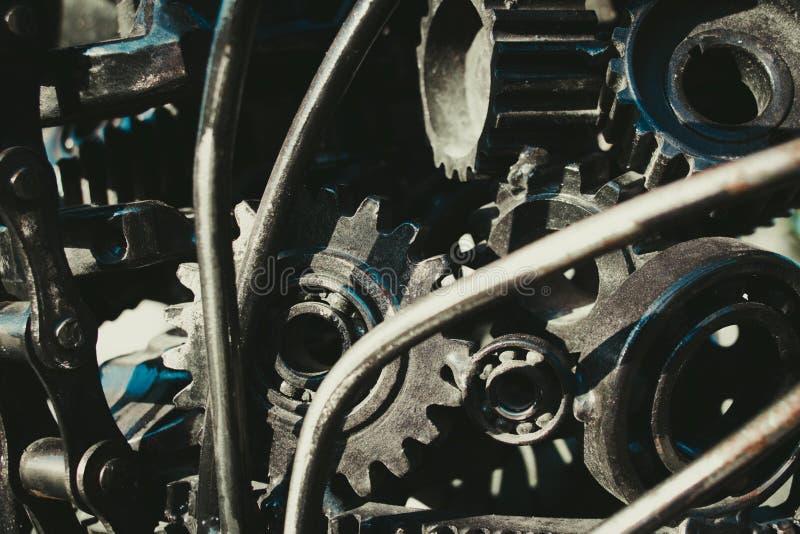Kugghjulen och lagren är församlade i ett stycke för avsikterna av konst royaltyfria foton