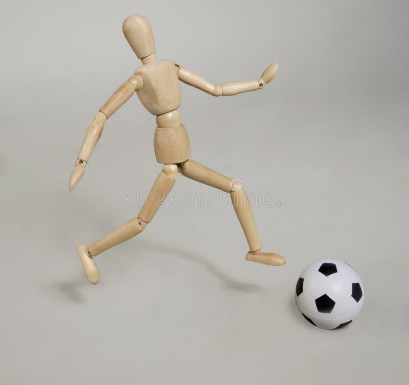 Kukła z piłki nożnej piłką zdjęcia royalty free