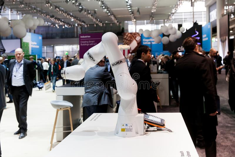 Kuka industrial robot hand in manufacturing industry on exhibition Cebit 2017 in Hannover Messe, Germany. Hannover, Germany - March, 2017: Kuka industrial robot royalty free stock photos