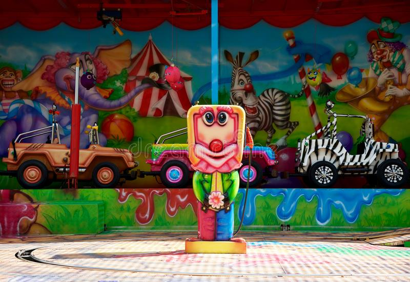 Kulör karusell för gyckeln av barn med bilar arkivfoton