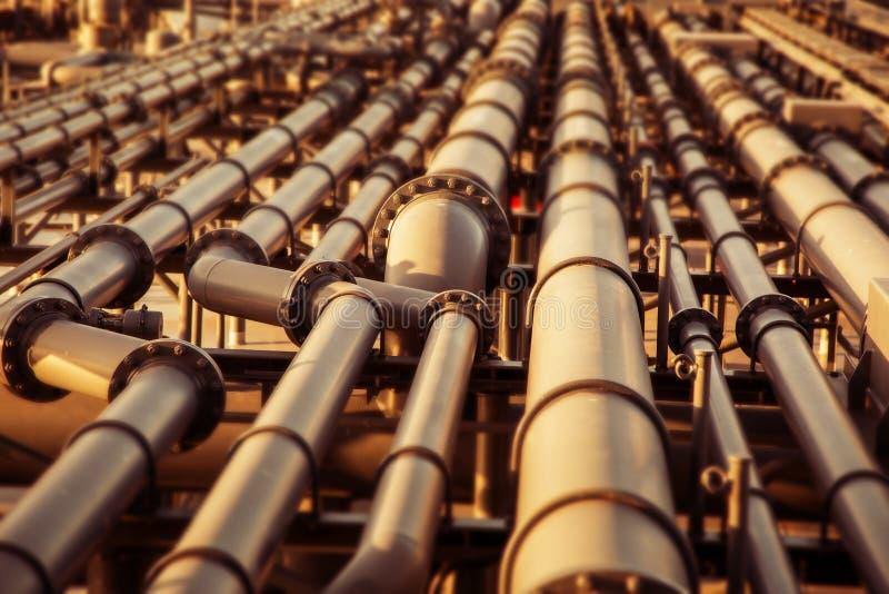 Kulör suddig bakgrund för olje- rörledning fotografering för bildbyråer