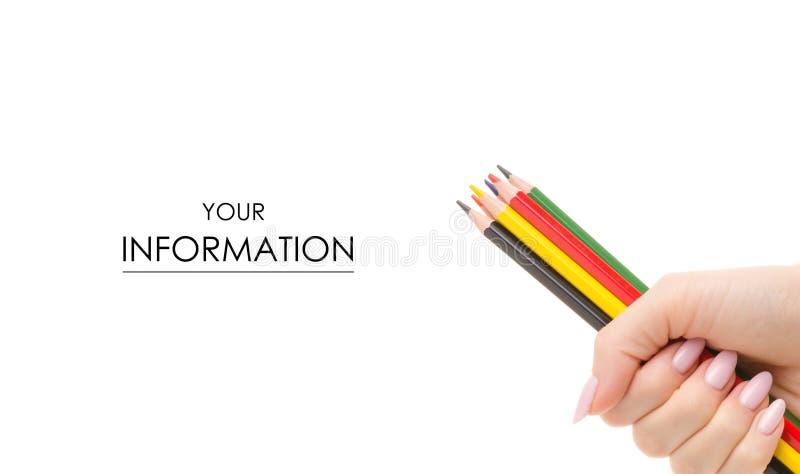 Kulöra blyertspennor i handmodell arkivbild
