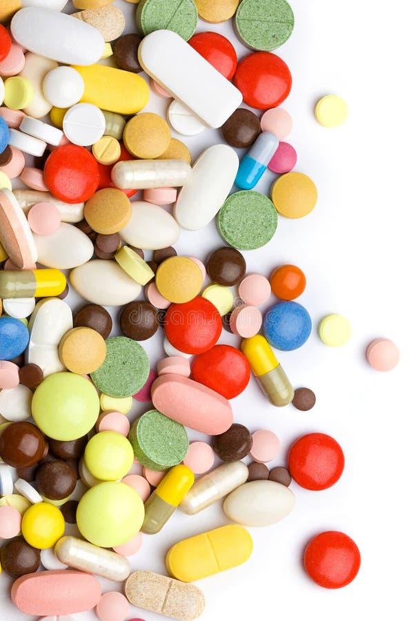Kulöra pills, tablets och kapslar fotografering för bildbyråer