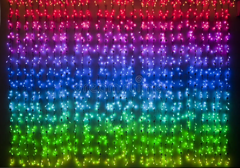 Kulöra xmas-ljus för regnbåge arkivfoton