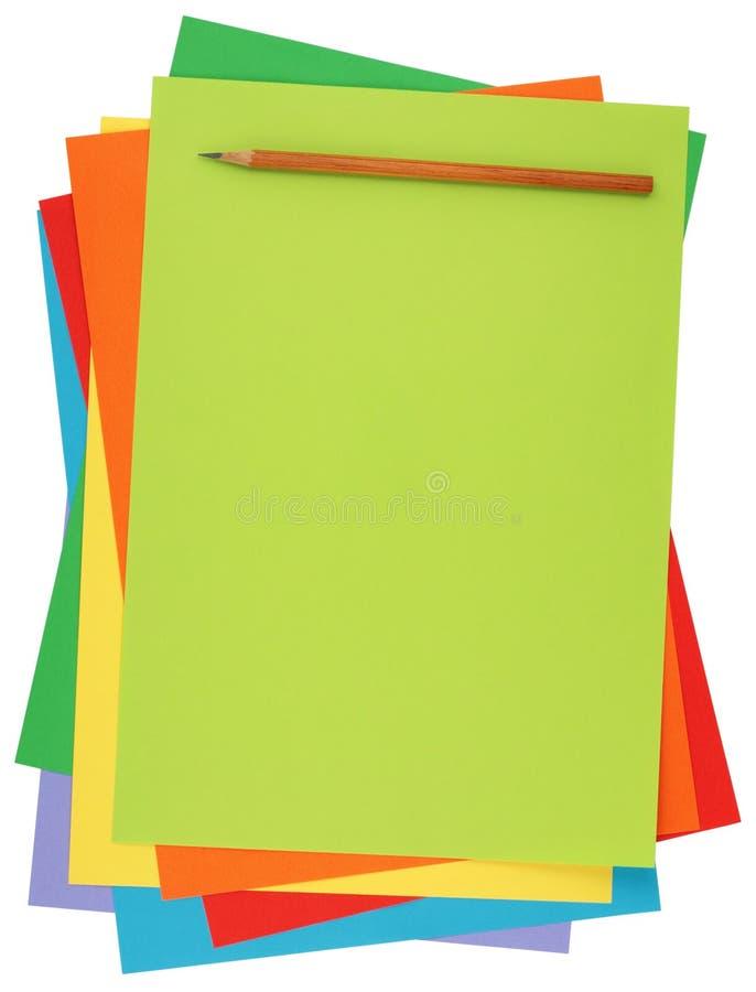 Kulört papper och blyertspenna royaltyfria foton