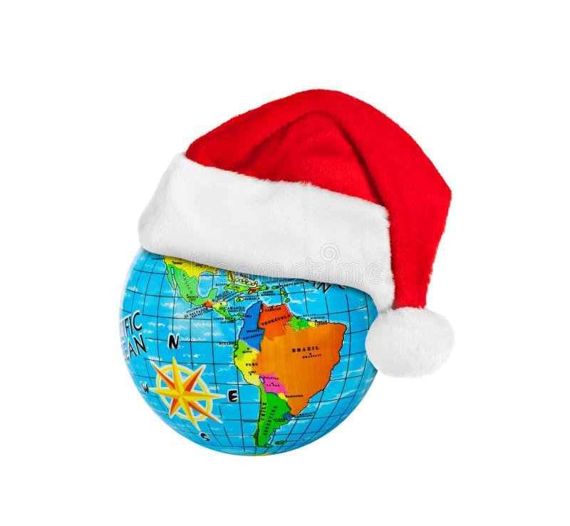 Kula ziemska i Święty Mikołaj czerwoni boże narodzenia kapeluszowi fotografia royalty free