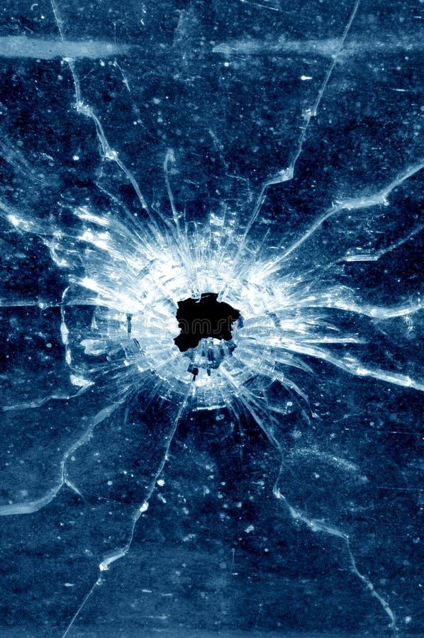 Kulhål i det glass fönstret royaltyfria foton