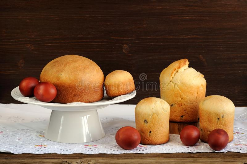 Kulichi, traditional Russian easter cakes and dyed eggs on white royalty free stock photography