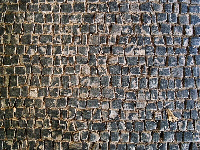 Kullerstentextur på jordningen arkivfoton