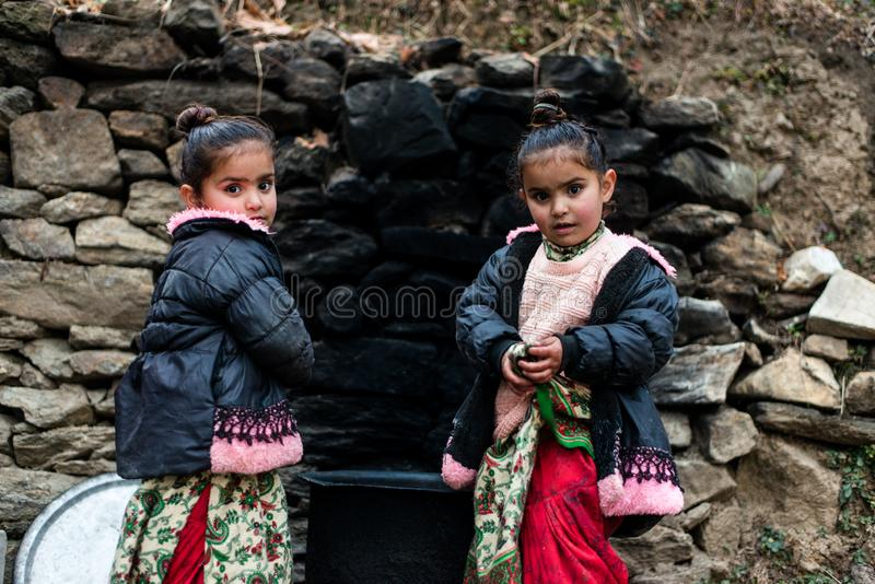 Kullu, Himachal Pradesh, India - December 21, 2018 : Photo of poor indian Twins girl child in mountains. Smile beautiful face female happy person portrait young royalty free stock image