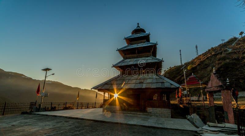 Kullu, Himachal Pradesh, India - December 07, 2018 : Sunset at manu rishi temple in himachal. India stock photography