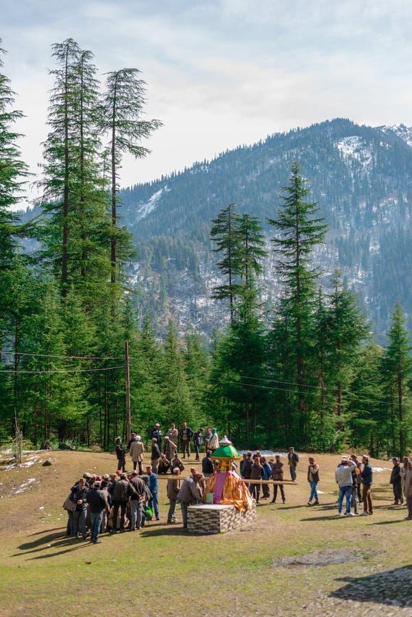 Kullu, Himachal Pradesh, India - February 13, 2018 : People doing worship local God ( Devta ) in Himalayas. Kullu, Himachal Pradesh, India -February 13, 2018 stock photo