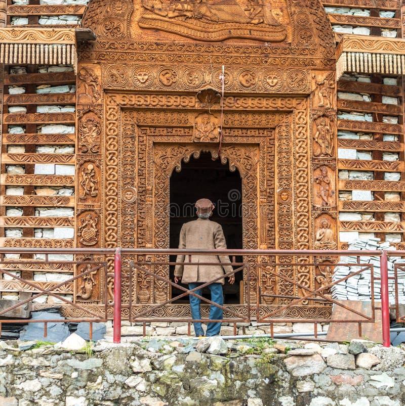 Kullu, Himachal Pradesh, India - September 01, 2018 : himachali old man at temple on the street in Himalayan village. Kullu, Himachal Pradesh, India - September stock photo