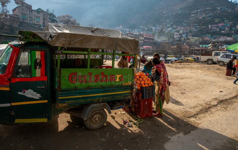 Street trade of  fruits in Kullu. 02/10/2019  Kullu  India ,  selling fruit on the street ÑŽ India oranges  in town. Tuk-tuk machine  similar  in India royalty free stock photography