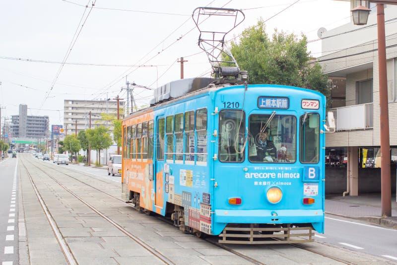 Kumamoto Tram,Japan. KUMAMOTO, JAPAN - December 5, 2015 : Classic tram of Kumamoto city at the tram stop in Kumamoto, Kyushu Island, Japan stock photos