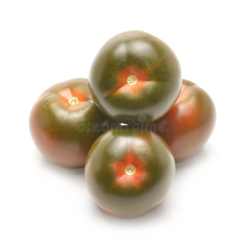 Kumato tomater som isoleras på vit bakgrund royaltyfria bilder