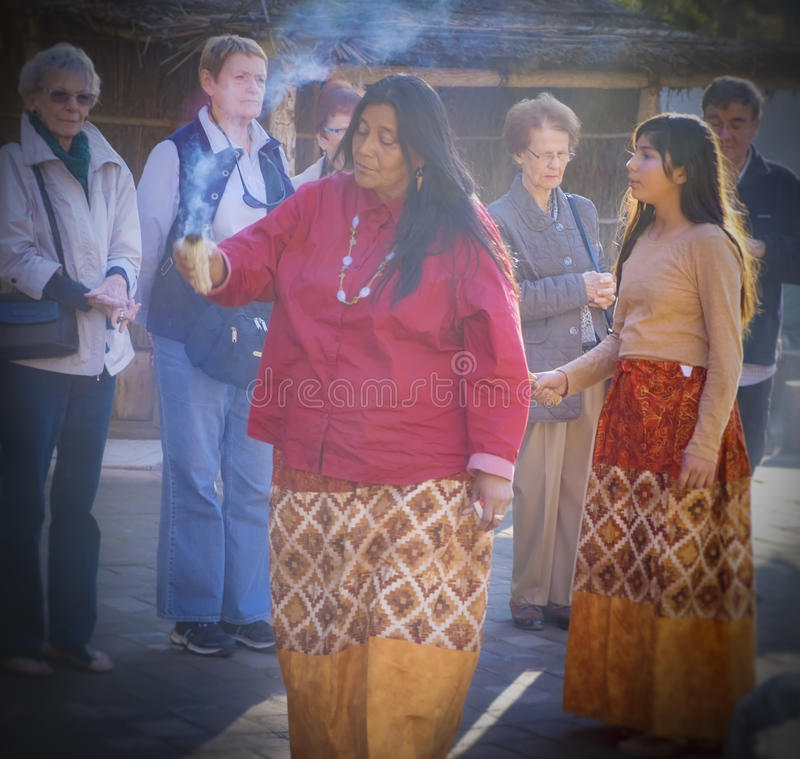 Kumeyaay Gives Blessing, Tecate, Mexico. A Kumeyaay, otherwise spelled as Kumiai, Indian woman gives a traditional blessing to a group of tourists with her stock photos