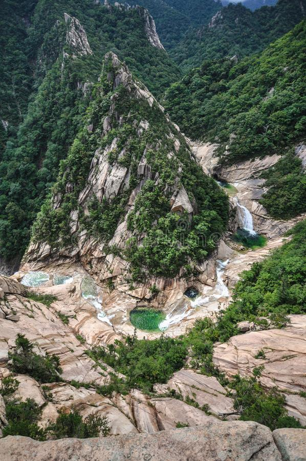 Kumgang San Mountain Range has 2 parts of which one is in South Korea and the other one in North Korea. The nine dragon water fall royalty free stock images