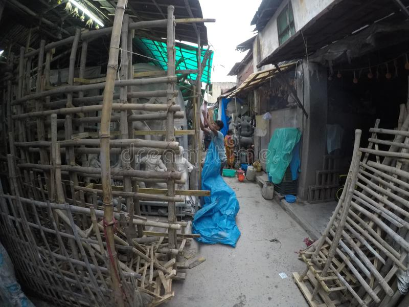 Kumortuli where major art and craft making happens for Daserra festival in kolkata. Kumortuli is officially known as porters quarter in Kolkata, where thousands stock images