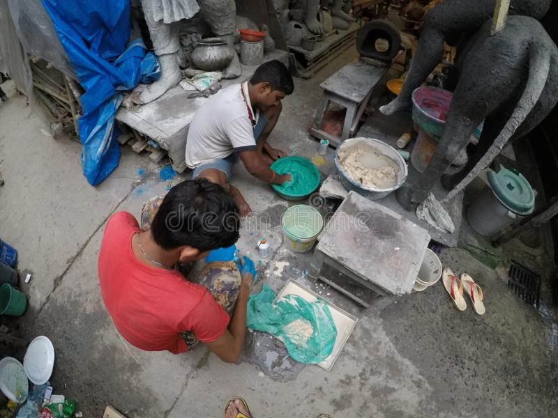 Kumortuli where major art and craft making happens for Daserra festival in kolkata. Kumortuli is officially known as porters quarter in Kolkata, where thousands royalty free stock images